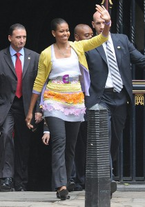 Michelle Obama waves to crowds of people waiting to catch a glimpse of the first lady during her trip to London. Photo: Jeremy Selwyn/Evening Standard/ZUMA Press - I mean...What?!