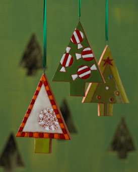 HANDMADE green XMAS TREE ORNAMENTS by artists FELIX KNIAZEV and OLGA JULINSKA at NM in HOME FOR THE HOLIDAYS on fashiondailymag
