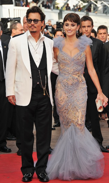 """96a5af574 CANNES, FRANCE – MAY 14: Actor Johnny Depp and actress Penelope Cruz on the  red carpet for the """"Pirates of the Caribbean: On Stranger Tides"""" official  ..."""