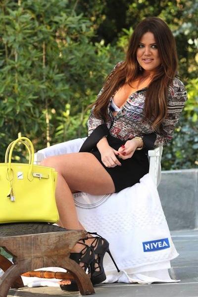 KHLOE KARDASHIAN in miami and nivea legs FashionDailyMag ss12 fashion