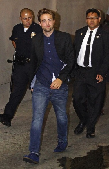 CATCHING up:  Robert Pattinson in jeans