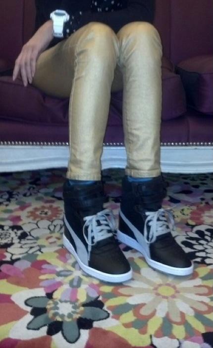 brigitte segura wearing puma wedges gold kancan jeans gshock watch