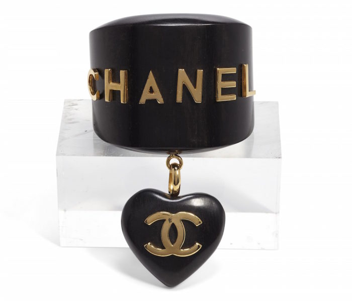 chanel jewelry A GOLD METAL CHARM BRACELETCHANEL and BIRKIN handbags x hype christies FashionDailyMag fashion brigitteseguracurator
